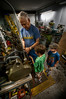 """My Dad teaching my boys how a lathe works in his personal machine shop that he put together with his Dad, my Grandfather""<br /> September 18th, 2010"