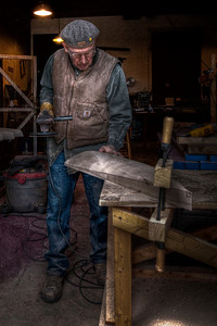 """The Wood Artist"" New Bedford, MA April 18th, 2010  Took this photograph of a New Bedford man working on his craft.  This was my first attempt at apply HDR to a person.  This is a HDR image from a single RAW file. f/4.0, ISO400 and heavily cropped"