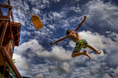 """Flying High Again"" August 11th, 2012 My son, Nicholas, jumping off his swing set at home Acushnet, MA"