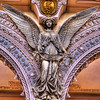 An angel underneath the clerestory. Angel refers to the office of divine messenger, and we see the angel bearing a message from God. Notice the emblem of St. Anthony's above the angel's head.