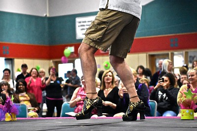 Gregg Foster of Rewood Capital Bank shows some leg and heels for some picture-taking dance appreciaters during the 10th anniversary of High Heels for Healing held Wednesday at the Adorni Center. (Jose Quezada - For the Times-Standard)