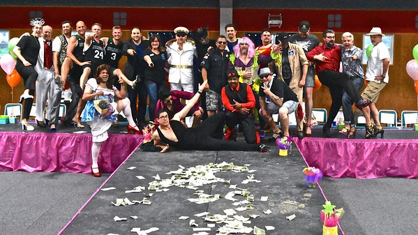 The entire cadre of sparkling high-heeled boys pose for a group shot at the end of the fundraiser. (Jose Quezada - For the Times-Standard)