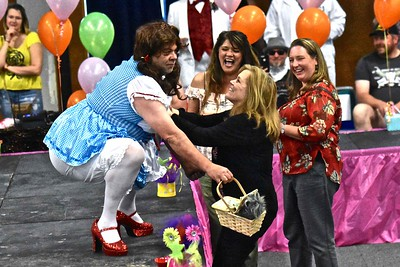 Dorothy (Dale Warmuth) gets a little rainbow smile and cold cash from Mary Huber Wallaker during the 10th anniversary of High Heels for Healing held Wednesday at the Adorni Center. (Jose Quezada - For the Times-Standard)
