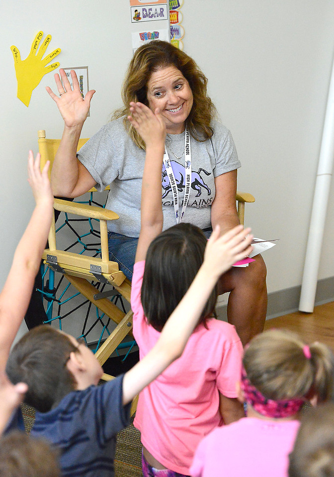 Third-grade teacher Terri Bellinghausen gets to know her students Friday, Aug. 19, 2016, on the first day of school at the new High Plains School in east Loveland. (Photo by Jenny Sparks/Loveland Reporter-Herald)