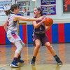 North Middlesex's Molly O'Neill defends Groton-Dunstable's Chloe MacDonald. Nashoba Valley Voice/Ed Niser