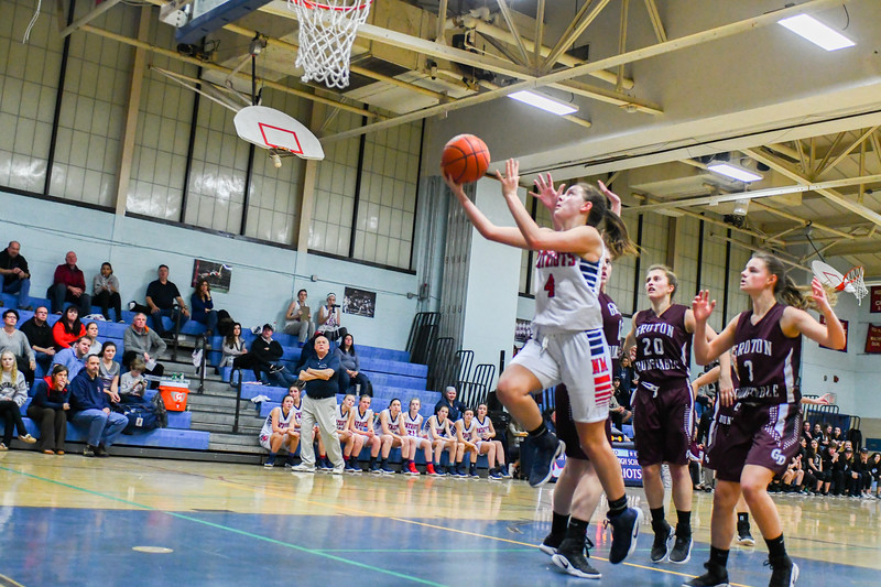 North Middlesex's Hadley Beauregard drives in for two in the second half of Friday night's overtime loss t Groton-Dunstable. Nashoba Valley Voice/Ed Niser