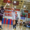 North Middlesex's Hadley Beauregard shoots a three-pointer as Groton-Dunstable's Hanna Van Pelt. Nashoba Valley Voice/Ed Niser