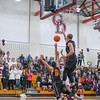 Groton-Dunstable's Evan cook shoots in traffic during Tuesday's win over Marlboro. Nashoba Valley Voice/Ed Niser