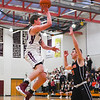 Groton-Dunstable's Ethan Cook prepares to shoot during Tuesday's win over Marlboro. Nashoba Valley Voice/Ed Niser