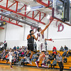 Groton-Dunstable's Gavin Keogh goes in for a layup as he blows by Marlboro's Hunter Reynolds. Nashoba Valley Voice/Ed Niser