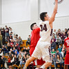 Groton-Dunstable's Gavin Keough puts up a shot during Friday night's game.Nashoba Valley Voice/Ed Niser
