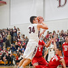 Groton-Dunstable's  Gavin Keough is whistled for a charge as Tyngsboro's Christian Beck falls to the floor. Nashoba Valley Voice/Ed Niser
