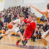 Groton-Dunstable's Evan Cook drives the lane during Friday night's win. Nashoba Valley Voice/Ed Niser