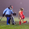 North Middlesex's Rachel Record makes a save on Tyngsboro's Taylor Anderson. Nashoba Valley Voice/Ed Niser