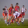 North Middlesex's Rachel Tortora advances the ball from the pack. Nashoba Valley Voice/Ed Niser