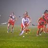 North Middlesex's Rachel Tortora advances the ball as he is chased by Tyngsboro's Angelise Melanson. Nashoba Valley Voice/Ed Niser