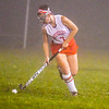 North Middlesx captain Alexis Reidy runs through the mist and fog with the ball during Tuesday's win. Nashoba Valley Voice/Ed Niser