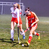 North Middlesex's Sydney Dickhaut pokes the ball away from Tyngsboro's Julia McGuire. Nashoba Valley Voice/Ed Niser