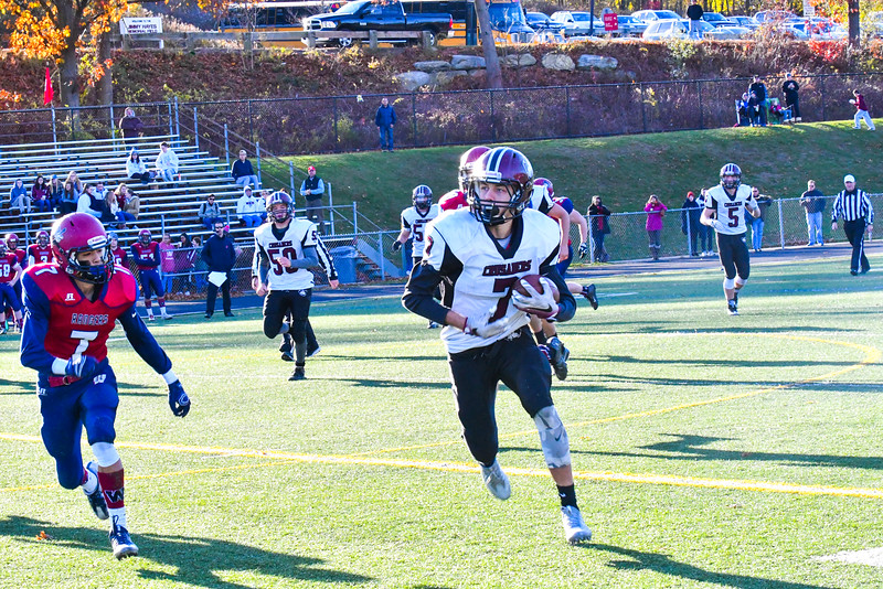 Groton-Dunstable's Nate Forbes runs with the ball after making a catch during Saturday's win.  Nashoba Valley Voice/Ed Niser