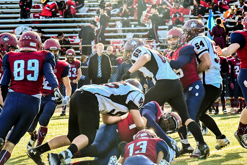 Groton-Dunstable offensive lineman Jack Erickson pancake blocks an oponent during Saturday's win over Westboro. Nashoba Valley Voice/Ed Niser