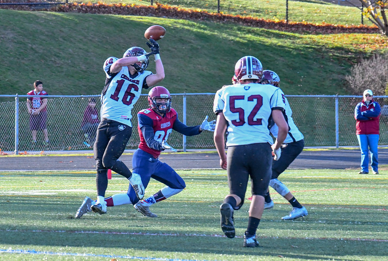 Groton-Dunstable's Mitch Townsend bats down a pass during Saturday's win over Westboro. Nashoba Valley Voice/Ed Niser