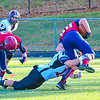 Groton-Dunstable's Chris Sweeny makes a tackle during Saturday's game. Nashoba Valley Voice/Ed Niser