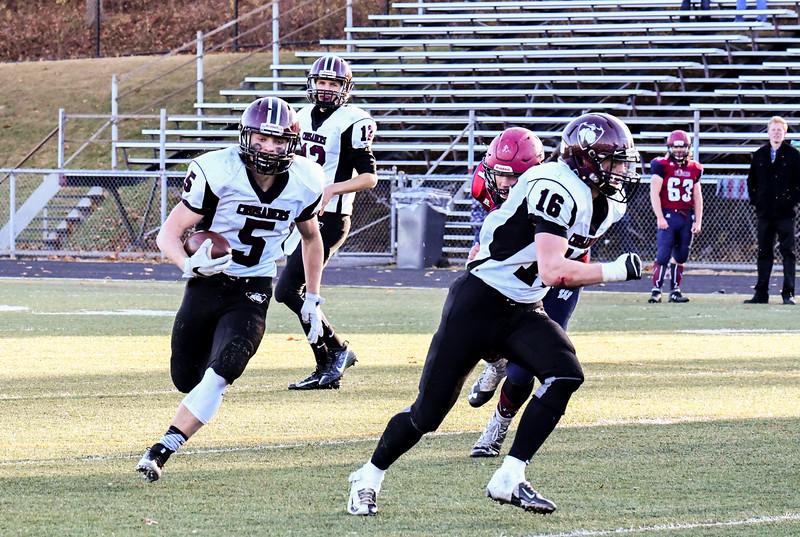 Logan Higgins runs with the ball behind teammate Mitch Townsend. Nashoba Valley Voice/Ed Niser