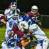 Ayer Shirley's Jimmy Robinson is stuffed by Lunenburg's Joe Nelson and George Khairalla. Nashoba Valley Voice/Ed Niser