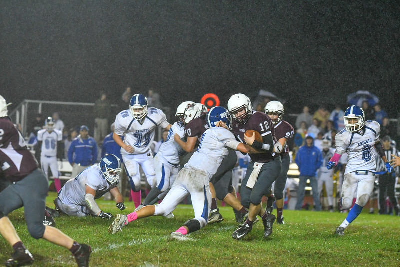 Ayer Shirley quarterback Steven Lawton is met at the line by Lunenburg's Kyle Crowley. Nashoba Valley Voice/Ed Niser