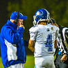 Lunenburg head coach Steve Boone relays the play to his quarterback Cody Murphy. Nashoba Valley Voice/Ed Niser