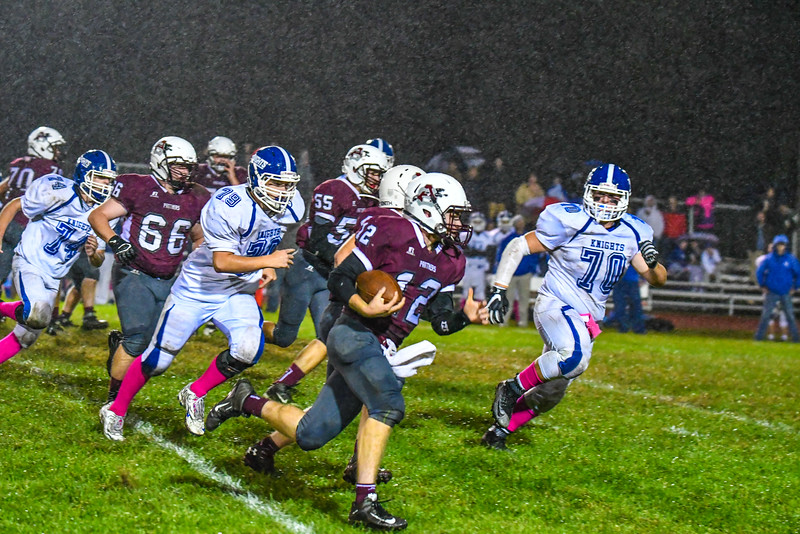 Ayer Shirley's Steven Lawton is pursued by Lunenburg defensive linemen George TIbbetts and Jarod Albert. Nashoba Valley Voice/Ed Niser