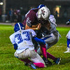 Ayer Shirley running back Jimmy Robinson is hit by Lunenburg's Nicholas Huntington and George Khairalla. Nashoba Valley Voice/Ed Niser