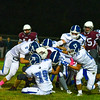 The Lunenburg defense stops Ayer Shirley back Jimmy Robinson in the backfield. Nashoba Valley Voice/Ed Niser