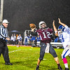 Ayer Shirley quarterback Steven Lawton is pressured by Lunenburg's Philip Drasser. Nashoba Valley Voice/Ed Niser