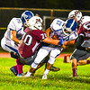 Ayer Shirley's Thomas Dentino sticks Lunenburg running back Brody Leinson. Nashoba Valley Voice/Ed Niser