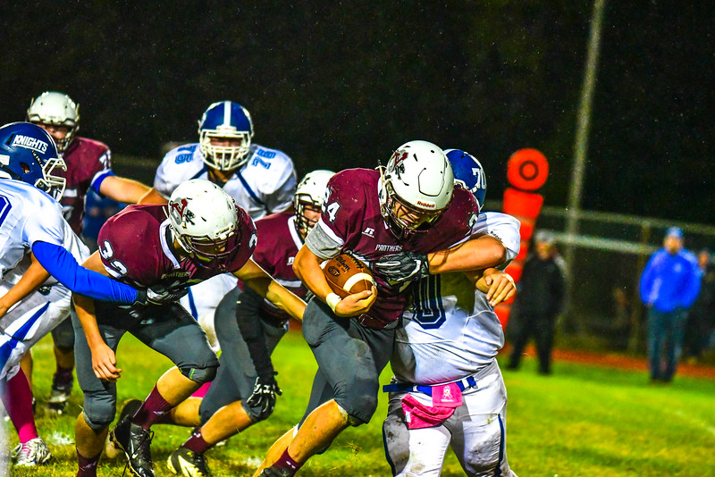 Ayer Shirley's Jimmy Robinson fights for extra yards as he is met by Lunenburg's Joseph Nelson. Nashoba Valley Voice/Ed Niser