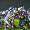 Ayer Shirley's Steven Lawton stiff-arms Lunenburg's Kyle Crowley. Nashoba Valley Voice/Ed Niser