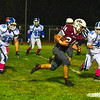 Ayer Shirley running back Jimmy Robinson take the ball into Lunenburg territory as Lunenburg's Jacob Bremer is in pursuit. Nashoba Valley Voice/Ed Niser