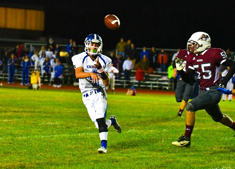 Lunenburg quarterback Cody Murphy throws a pass as Ayer Shirley linebacker Jaden Hamilton closes in. Nashoba Valley Voice/Ed Niser