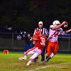North MIddlesex senior linebacker Jake Hachey sacks Tyngsboro quarterback Alex Makos in the first half of Friday's win. Nashoba Valley Voice/Ed Niser