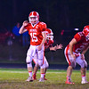 North Middlesex quarterback looks to the sideline during a play in Friday night's game. Nashoba Valley Voice/Ed Niser