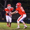 North Middlesex quarterback Joe Haskins presents the ball to running back Dan DiPano. Nashoba Valley Voice/Ed Niser