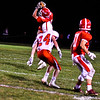 North Middlesex's Jake Hachey pulls in a reception over Tyngsboro's Matt Butler. Nashoba Valley Voice/Ed Niser