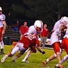 North Middlesex's Jake Hachey wraps up Tyngsboro running back Matt Butler. Nashoba Valley Voice/Ed Niser