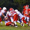 The Tyngsboro defense converge for a tackle during Friday's Mid Wach C loss to North Middlesex. Nashoba Valley Voice/Ed Niser