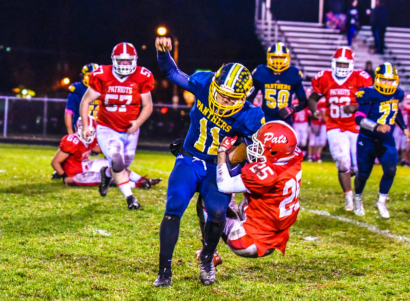 North Middlesex defensive back Xavier Marty drags Quabbin running back Colby Smith to the ground during their game in Townsend on Friday, Oct. 28, 2016. Sentinel & Enterprise/Ed Niser