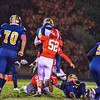 North Middlesex's Alex Hollenbeck lays a hit on Quabbin quarterback Ryan Malkowski. Nashoba Valley Voice/ed Niser