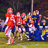 Joe Haskins fights through contact as teammate Zac Wheeler (21) tries to push the pile.