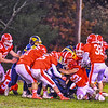 Quabbin quarterback Ryan Malkowski is tackled by a host of North Middlesex defenders. Nashoba Valley Voice/Ed Niser