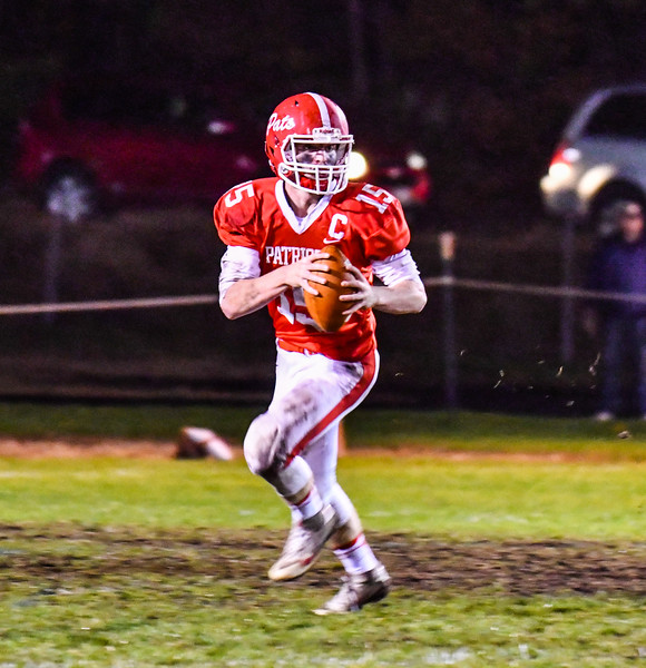 North Middlesex quarterback Joe Haskins looks to pass during Friday night's loss. Nashoba Valley Voice/Ed Niser